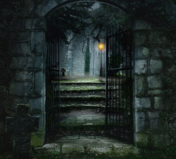 Dark Cemetery with Gated Archway and Steps Up to Street Lamp