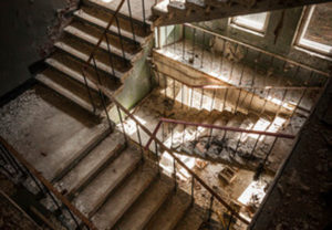 Abandoned Staircase with Rubble and Debris